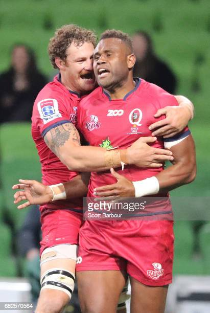 Eto Nabuli of the Reds is congratulated Scott Higginbotham after scoring a try during the round 12 Super Rugby match between the Melbourne Rebels and...