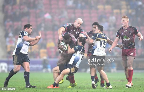 Eto Nabuli of the Reds is tackled during the round 16 Super Rugby match between the Reds and the Brumbies at Suncorp Stadium on July 7 2017 in...