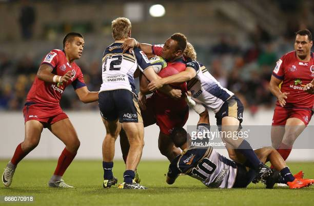 Eto Nabuli of the Reds is tackled during the round seven Super Rugby match between the Brumbies and the Reds at GIO Stadium on April 8 2017 in...