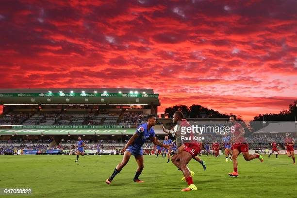 Eto Nabuli of the Reds looks to avoid being tackled by Chance Peni of the Force during the round two Super Rugby match between the Western Force and...