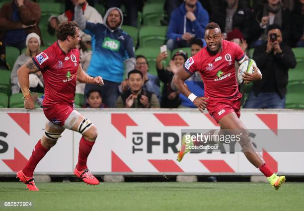 Eto Nabuli of the Reds runs in to score a try during the round 12 Super Rugby match between the Melbourne Rebels and the Queensland Reds at AAMI Park...