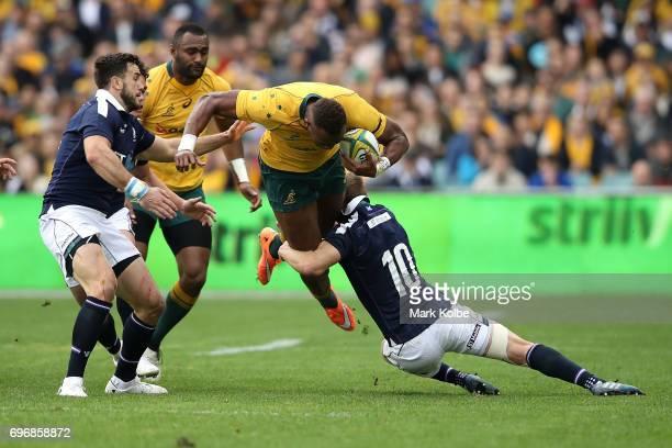Eto Nabuli of the Wallabies is tackled by Finn Russell of Scotland during the International Test match between the Australian Wallabies and Scotland...