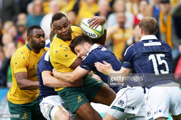 Eto Nabuli of the Wallabies is tackled during the International Test match between the Australian Wallabies and Scotland at Allianz Stadium on June...