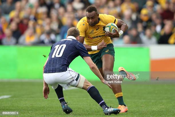 Eto Nabuli of the Wallabies runs the ball during the International Test match between the Australian Wallabies and Scotland at Allianz Stadium on...