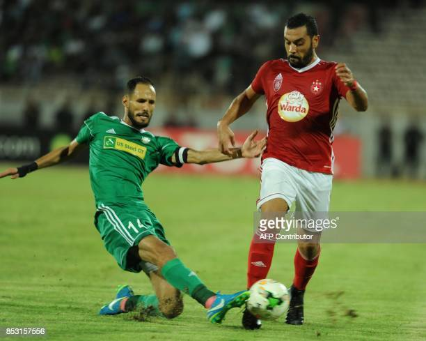 Etoile du Sahel's striker Alaya Brigui vies with Ahly Tripoli's forward Ali Ramdan Salama during the African Champions league quarterfinal football...