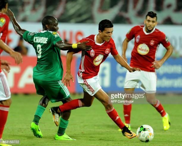 Etoile du Sahel's striker Amine Chemiti vies with Ahly Tripoli's forward Vivien Mabide during the African Champions league quarterfinal football...