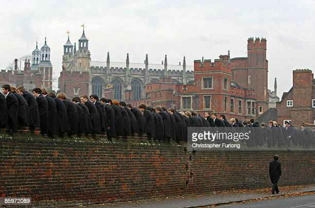 Eton boys perched on the wall watch the tradtional wall game on November 17 2007 in Eton England The game which is unique to Eton is played between...