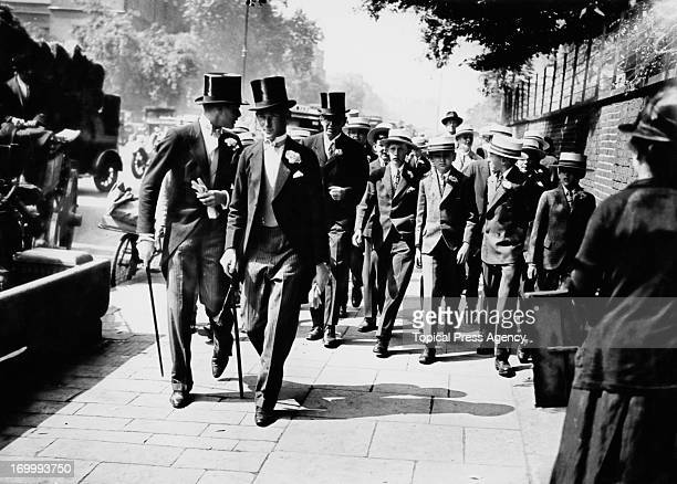 Eton schoolboys arriving at Lord's Cricket Ground London for the Eton versus Harrow cricket match 13th July 1928