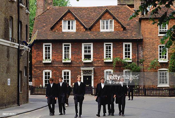 Eton schoolboys in traditional tailcoats at Eton College boarding school Berkshire UK