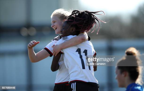 Etonam Nicole Anyomi celebrates scoring with AnnaLena Stolze of Germany during the Germany v Italy U17 Girl's Elite Round at Keys Park on March 25...