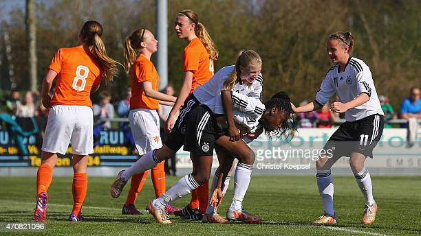 Etonam Nicole Anyomi of Germany celebrates the first goal with AnnaLena Stolze and Verene Wieder of Germany during the U15 girl's international...