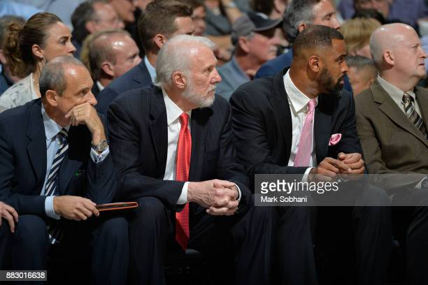 Ettore Messina Gregg Popovich and Ime Udoka of the San Antonio Spurs sit on the benchnduring the game against the Memphis Grizzlies on November 29...