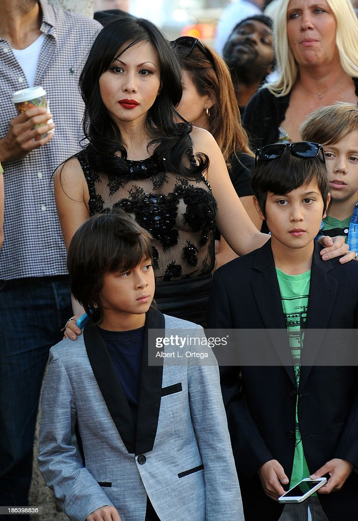 Etty Lau Farrell ands sons Izzadore Bravo, Hezron Wolfgang attend as Jane's Addiction is Honored On The Hollywood Walk Of Fame on October 30, 2013 in Hollywood, California.