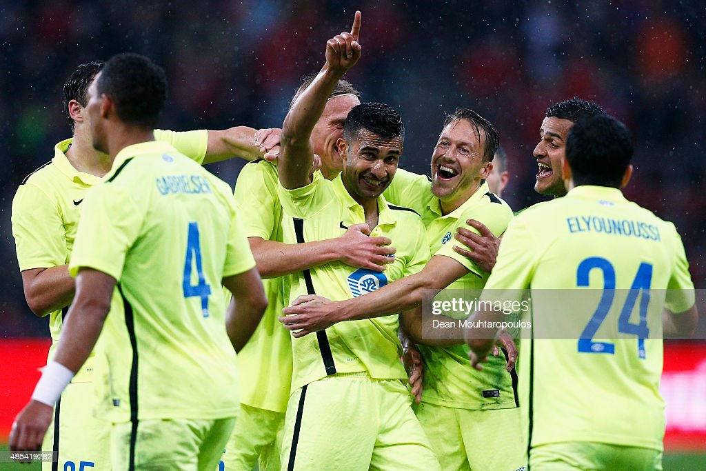 Etzaz Hussain of Molde FK celebrates scoring his teams first goal of the game with team mates during the UEFA Europa League play off round second leg...