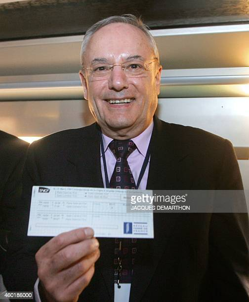 Eu transport commissioner Jacques Barrot poses with his ticket aboard the brand new TGV as he attends the inaugural departure of the TGVEst 15 March...