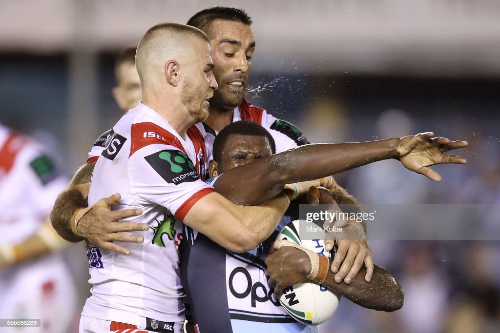 Euan Aitken and Paul Vaughan of the Dragons tackle Edrick Lee of the Sharks during the round three NRL match between the Cronulla Sharks and the St George Illawarra Dragons at Southern Cross Group Stadium on March 19, 2017 in Sydney, Australia.