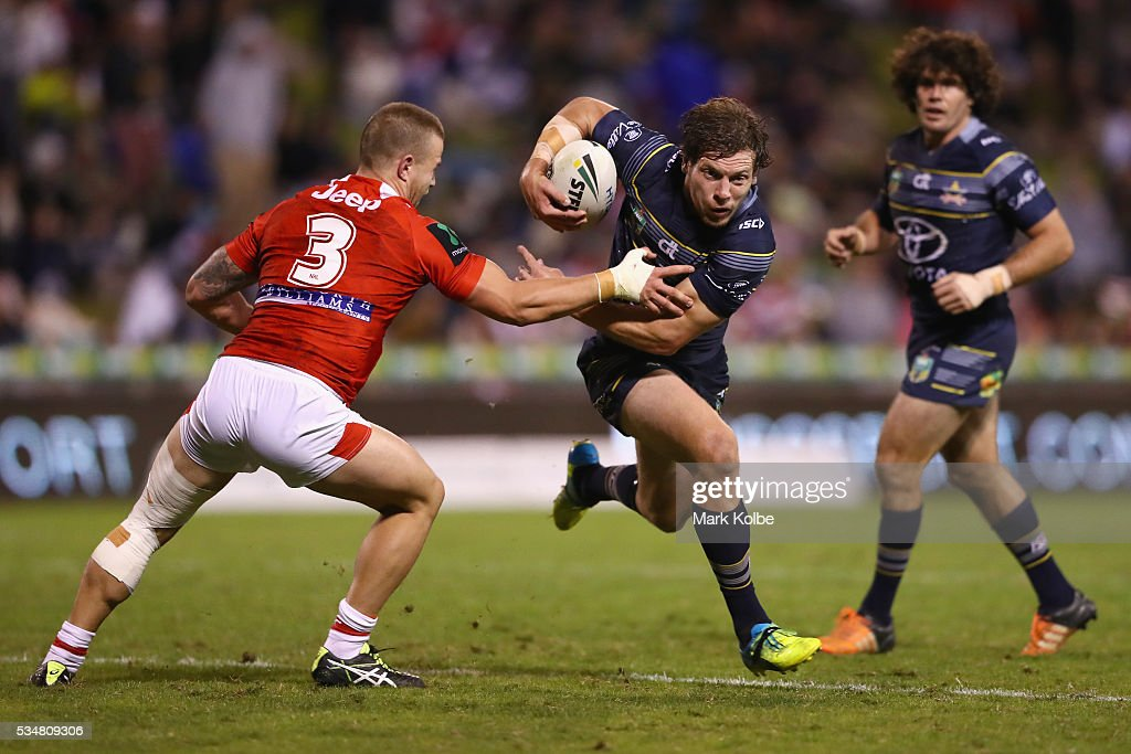 Euan Aitken of the Dragons attempts to tackle Rory Kostjasyn of the Cowboys during the round 12 NRL match between the St George Illawarra Dragons and the North Queensland Cowboys at WIN Jubilee Stadium on May 28, 2016 in Wollongong, Australia.