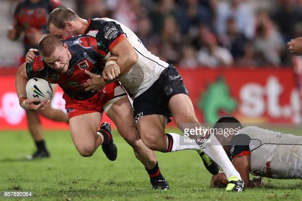 Euan Aitken of the Dragons is tackled by Simon Mannering of the Warriors during the round four NRL match between the St George Illawarra Dragons and...