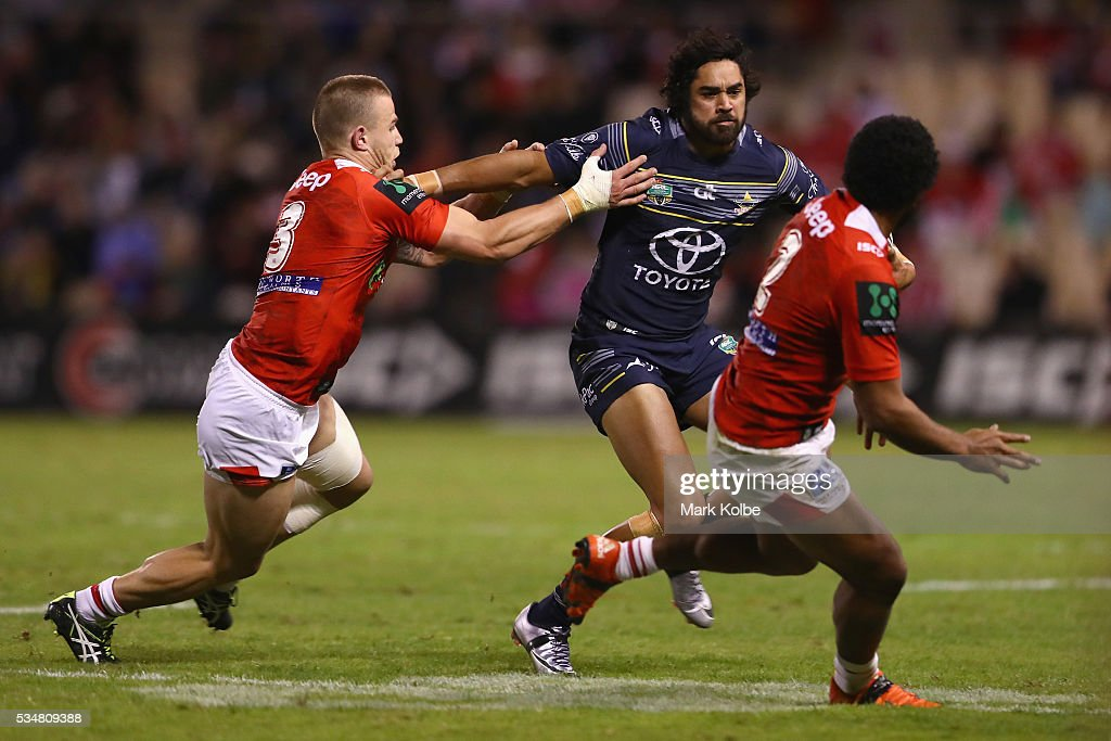 Euan Aitken of the Dragons tackles Javid Bowen of the Cowboys during the round 12 NRL match between the St George Illawarra Dragons and the North Queensland Cowboys at WIN Jubilee Stadium on May 28, 2016 in Wollongong, Australia.