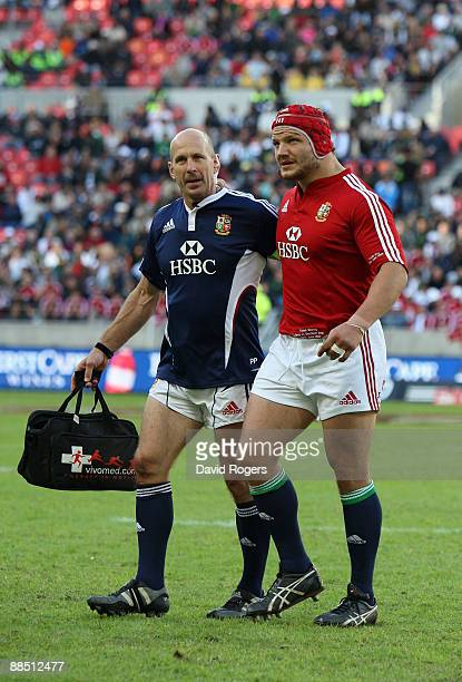 Euan Murray of the Lions is helped off the pitch by physio Phil Pask during the match between the Southern Kings and the British and Irish Lions on...