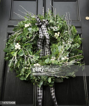 Eucalyptus wreath - modern Christmas wreath hung on a black door : Stock Photo