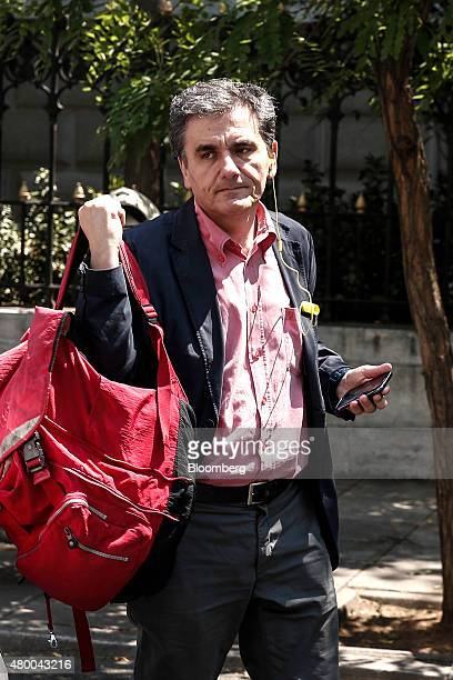 Euclid Tsakalatos Greece's finance minister listens to a mobile device as he arrives at the finance ministry in Athens Greece on Thursday July 9 2015...