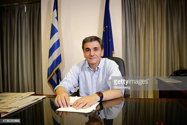 Euclid Tsakalotos Greece's deputy foreign minister poses for a photograph following a Bloomberg Television interview at his office in Athens Greece...