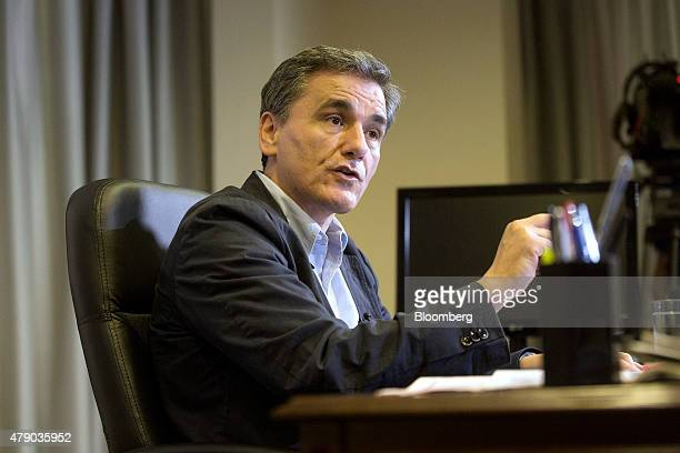 Euclid Tsakalotos Greece's deputy foreign minister speaks during a Bloomberg Television interview at his office in Athens Greece on Tuesday June 30...