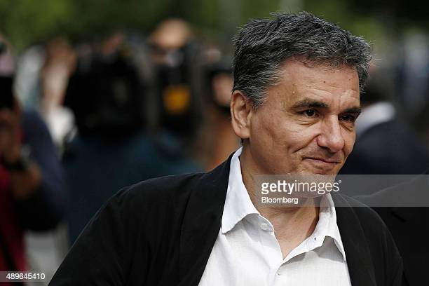 Euclid Tsakalotos Greece's finance minister arrives at the presidential palace for a swearing in ceremony of new cabinet ministers in Athens Greece...
