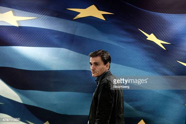 Euclid Tsakalotos Greece's finance minister arrives for a handover ceremony following his appointment in Athens Greece on Monday July 6 2015...