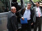 Euclid Tsakalotos Greece's finance minister center reacts as he arrives for a Eurogroup meeting of European finance ministers in Brussels Belgium on...