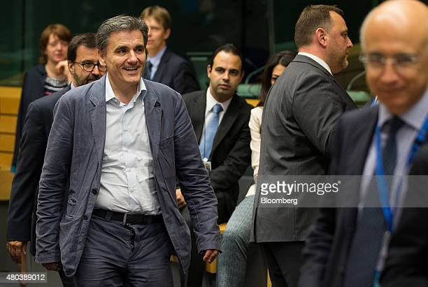Euclid Tsakalotos Greece's finance minister left arrives ahead of a meeting of European finance ministers in Brussels Belgium on Saturday July 11...