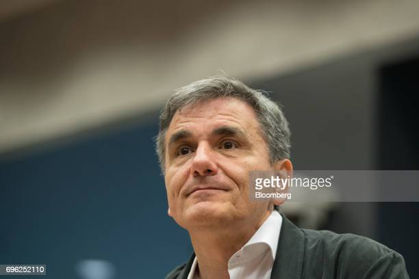 Euclid Tsakalotos Greece's finance minister looks on ahead of a Eurogroup meeting of European finance ministers in Luxembourg on Thursday June 15...