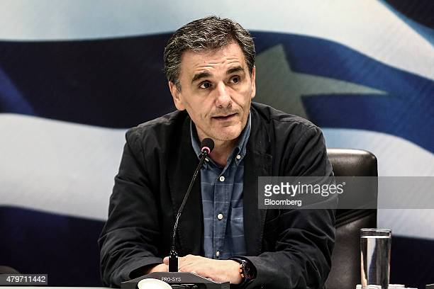 Euclid Tsakalotos Greece's finance minister right addresses journalists during a handover ceremony in Athens Greece on Monday July 6 2015 Tsakalotos...