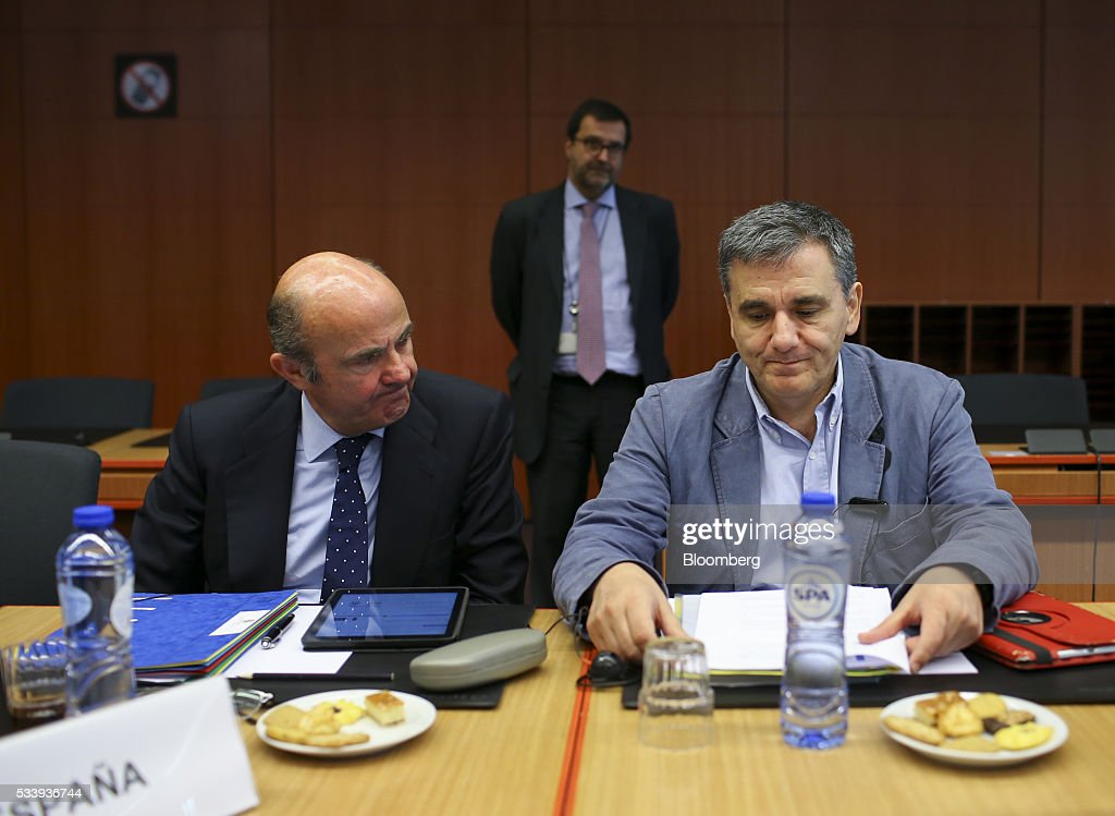 Euclid Tsakalotos, Greece's finance minister, right, sits beside Luis de Guindos, Spain's economy minister, during a Eurogroup meeting of European finance ministers in Brussels, Belgium, on Tuesday, May 24, 2016. Five years after handing Greece the biggest sovereign-debt write-off in history, European policy makers have come full circle to the point they had all hoped to avoid: a real discussion on debt relief. Photographer: Jasper Juinen/Bloomberg via Getty Images