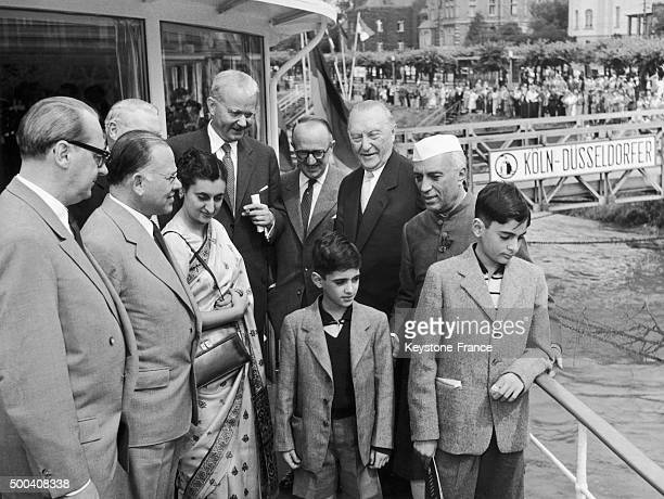 Eugen Gerstenmaier President of the German federal assembly Franz Blucher Vicechancellor of Western Germany and Konrad Adenauer welcoming Jawaharlal...