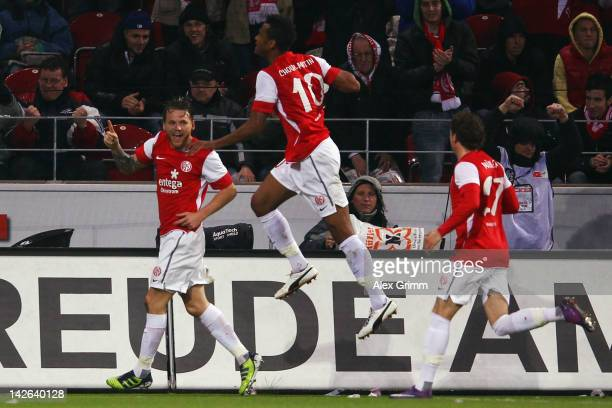 Eugen Polanski celebrates his team's first goal with team mates Eric Maxim ChoupoMoting and Nicolai Mueller during the Bundesliga match between...