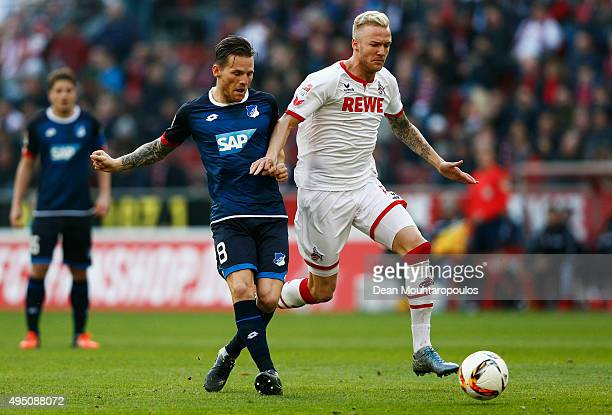Eugen Polanski of Hoffenheim battles for the ball with Kevin Vogt of koeln during the Bundesliga match between 1 FC Koeln and TSG 1899 Hoffenheim...