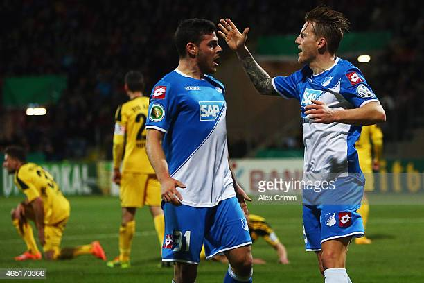 Eugen Polanski of Hoffenheim celebrates his team's first goal with team mate Kevin Volland during the DFB Cup Round of 16 match between VfR Aalen and...