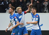 Eugen Polanski of Hoffenheim celebrates with his teammates after scoring his team's second goal during the Bundesliga match between 1899 Hoffenheim...