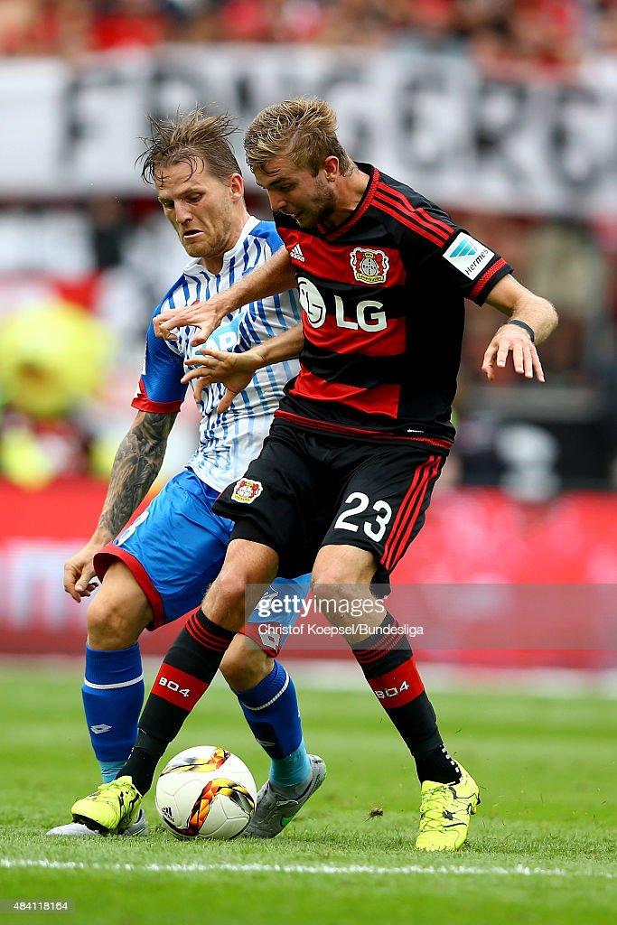 Eugen Polanski of Hoffenheim challenges Christoph Kramer of Leverkusen during the Bundesliga match between Bayer Leverkusen and 1899 Hoffenheim at BayArena on August 15, 2015 in Leverkusen, Germany.