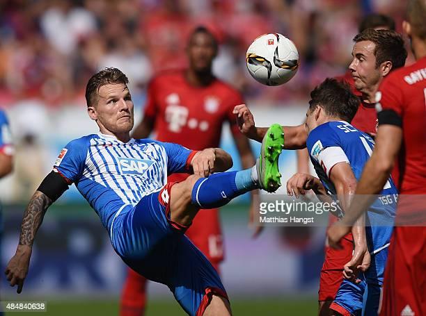 Eugen Polanski of Hoffenheim controls the ball against Mario Goetze of Muenchen during the Bundesliga match between 1899 Hoffenheim and FC Bayern...