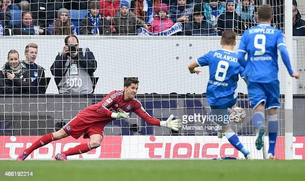 Eugen Polanski of Hoffenheim scores his team's first goal by a penalty kick past goalkeeper Rene Adler of Hamburg during the Bundesliga match between...