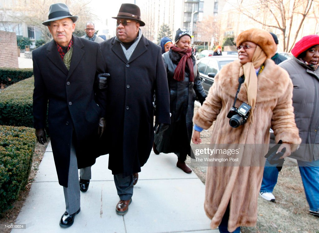 Eugene Allen, (L-R) son Charles Allen and Ortaciana Allen make their way to the Capitol Building for the inauguration of Barack Obama Tuesday afternoon. Photographed January 20, 2009 in Washington, DC.