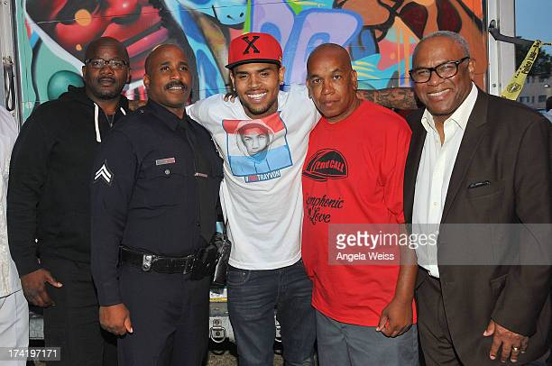 Eugene 'Big U' Henley Dave Love Chris Brown Skipp Townsend and Deputy Mayor Guillermo Cespedes unite at The Jungles on July 20 2013 in Los Angeles...