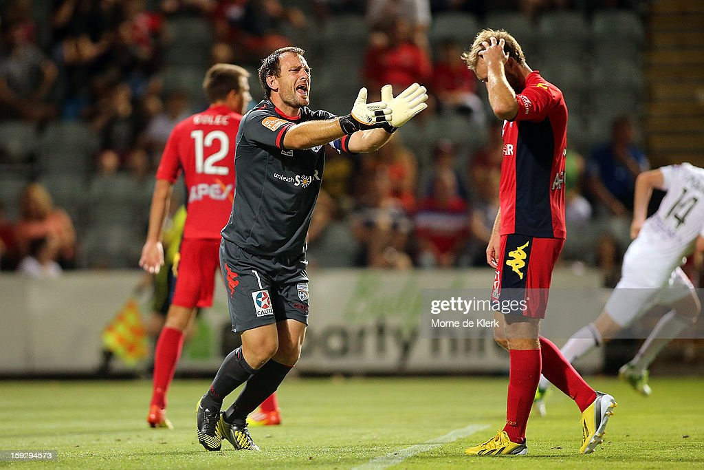 Eugene Galekovic and Iain Fyfe of Adelaide react during the round 16 A-League match between Adelaide United and the Perth Glory at Hindmarsh Stadium on January 11, 2013 in Adelaide, Australia.