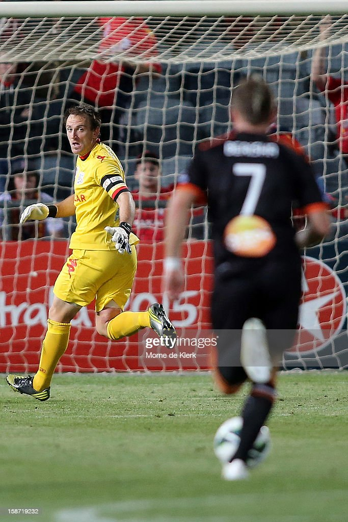 Eugene Galekovic of Adelaide gets back in goal as <a gi-track='captionPersonalityLinkClicked' href=/galleries/search?phrase=Besart+Berisha&family=editorial&specificpeople=737057 ng-click='$event.stopPropagation()'>Besart Berisha</a> of Brisbane runs with the ball during the round 13 A-League match between Adelaide United and the Brisbane Roar at Hindmarsh Stadium on December 26, 2012 in Adelaide, Australia.