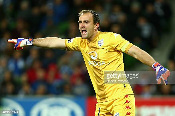 Eugene Galekovic of Adelaide gives instructions to teammates during the FFA Cup Quarter Final match between the Melbourne Victory and Adelaide United...