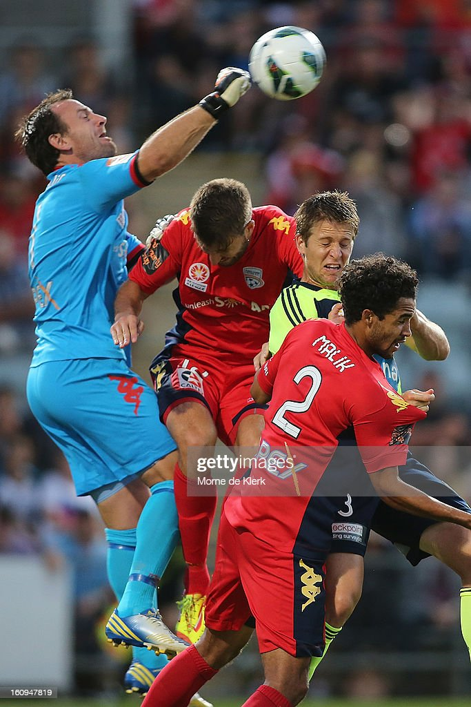 Eugene Galekovic (L) of Adelaide makes a save during the round 20 A-League match between Adelaide United and the Melbourne Victory at Hindmarsh Stadium on February 8, 2013 in Adelaide, Australia.