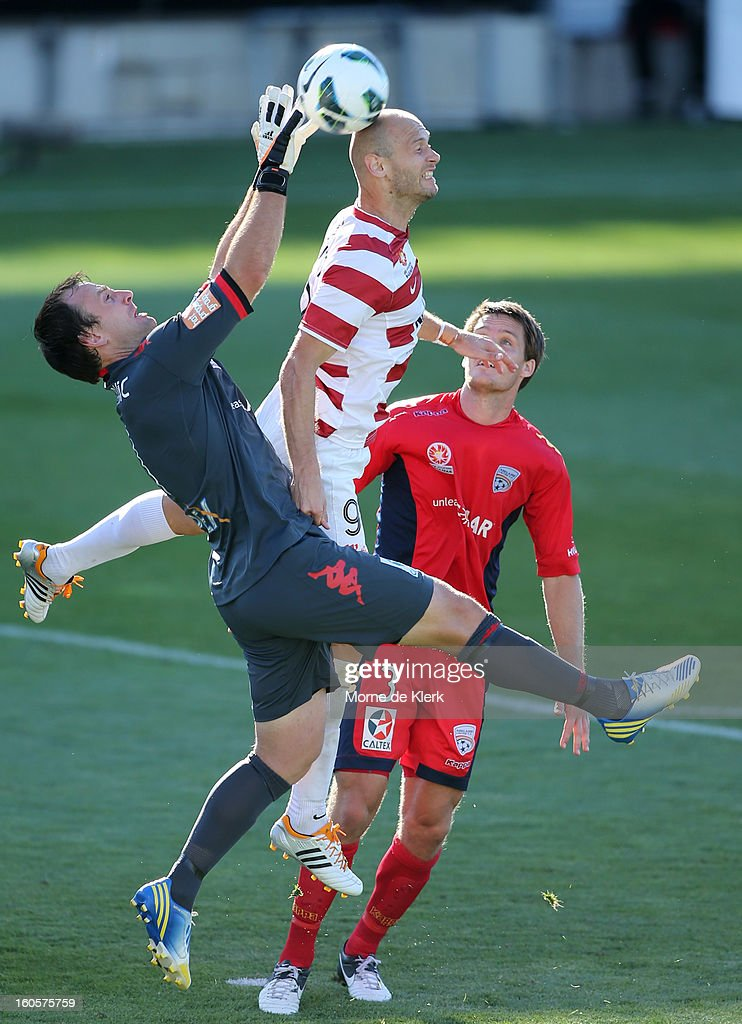 Eugene Galekovic of Adelaide makes a save under pressure from Dino Kresinger of Western Sydney during the round 19 A-League match between Adelaide United and the Western Sydney Wanderers at Hindmarsh Stadium on February 3, 2013 in Adelaide, Australia.
